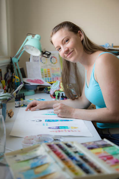 Artist printmaker working in her studio